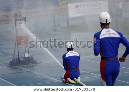 ST. PETERSBURG, RUSSIA - SEPTEMBER 9, 2015: Team Czech Republic during competitions in combat deployment during XI World Championship in Fire and Rescue Sport. 1st World Championship was held in 2002 - stock photo
