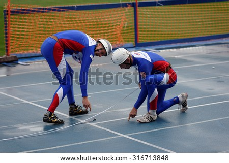 ST. PETERSBURG, RUSSIA - SEPTEMBER 9, 2015: Team Czech Republic prepare to competitions in combat deployment during XI World Championship in Fire and Rescue Sport. 1st World Championship held in 2002 - stock photo