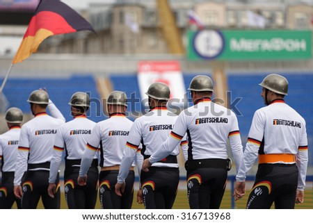 ST. PETERSBURG, RUSSIA - SEPTEMBER 9, 2015: Team Germany before competitions in combat deployment during the XI World Championship in Fire and Rescue Sport. First World Championship was held in 2002 - stock photo