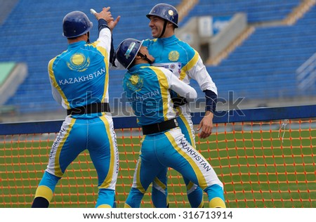 ST. PETERSBURG, RUSSIA - SEPTEMBER 9, 2015: Team Kazakhstan celebrate good result in competitions in combat deployment during XI World Championship in Fire and Rescue Sport - stock photo
