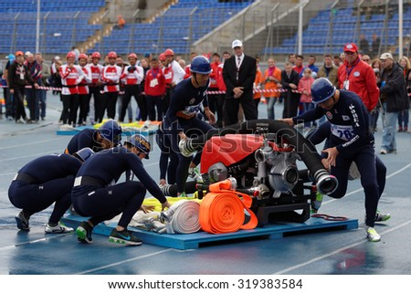 ST. PETERSBURG, RUSSIA - SEPTEMBER 9, 2015: Team Korea during competitions in combat deployment during XI World Championship in Fire and Rescue Sport. First World Championship was held in 2002 - stock photo
