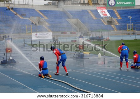ST. PETERSBURG, RUSSIA - SEPTEMBER 9, 2015: Team Russia during competitions in combat deployment during the XI World Championship in Fire and Rescue Sport. First World Championship was held in 2002 - stock photo