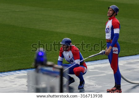 ST. PETERSBURG, RUSSIA - SEPTEMBER 9, 2015: Team Slovakia during competitions in combat deployment during the XI World Championship in Fire and Rescue Sport. First World Championship was held in 2002 - stock photo