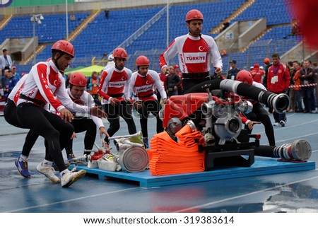 ST. PETERSBURG, RUSSIA - SEPTEMBER 9, 2015: Team Turkey during competitions in combat deployment during XI World Championship in Fire and Rescue Sport. First World Championship was held in 2002 - stock photo