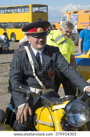 "ST. PETERSBURG, RUSSIA - SEPTEMBER 07, 2014: The participant of parade of vintage vehicles in the form of Soviet traffic police officer on a police motorcycle ""Ural"""