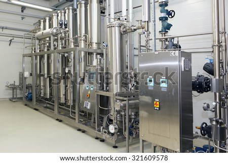 ST. PETERSBURG, RUSSIA - SEPTEMBER 24, 2015: Water purification equipment on the Solopharm plant. The new modern pharmaceutical plant was built in accordance with Good Manufacturing Practice standards - stock photo