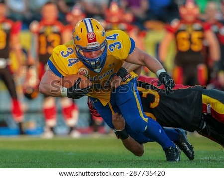 ST. POELTEN, AUSTRIA - JUNE 3, 2014: RB Jonathan Wikstrom (#34 Sweden) is tackled by an opponent during the Football EC European Championchip in St Poelten, Austria. - stock photo