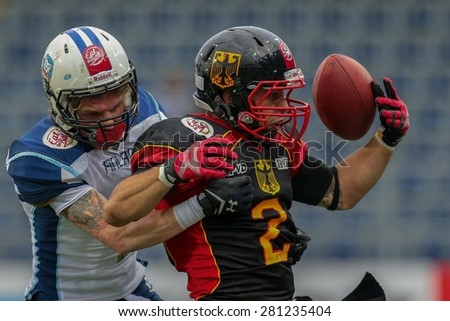ST. POELTEN, AUSTRIA - MAY 30, 2014: RB Danny Washington (#2 Germany) is tackled by DB Pekka Rantala (#4 Finland) during the EFAF European Championships 2014 in Austria. - stock photo