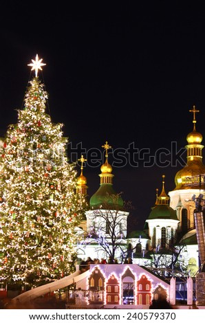 St. Sophia Cathedral, Christmas market, and main Kyiv's New Year tree on Sophia Square in Kyiv, Ukraine - stock photo