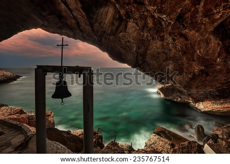 St. Stephan cave with sea view through a simple belfry  - stock photo