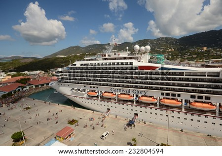 ST THOMAS - MARCH 26: Carnival's Glory ocean liner arrives in St Thomas, US Virgin Islands on March 26, 2014. St Thomas is a popular cruise destination. - stock photo
