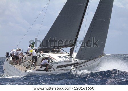 ST. THOMAS, USVI - MARCH 24:  Antilope races out of Charlotte Amalie Harbor during 2011 International Rolex Regatta in St. Thomas, USVI on March 24, 2012 - stock photo