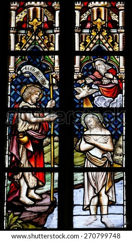 ST TRUIDEN, BELGIUM - APRIL 21, 2013: Stained glass window, depicting the Baptism of Jesus by Saint John, in the Cathedral of Saint Truiden in Limburg, Belgium. - stock photo
