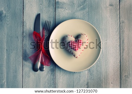 St Valentine's day greeting card with plate, knife, fork and heart - stock photo