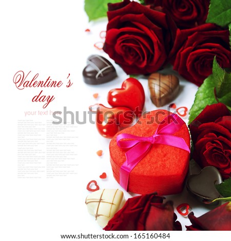 St. Valentine's Day roses and chocolate over white (with easy removable text) - stock photo