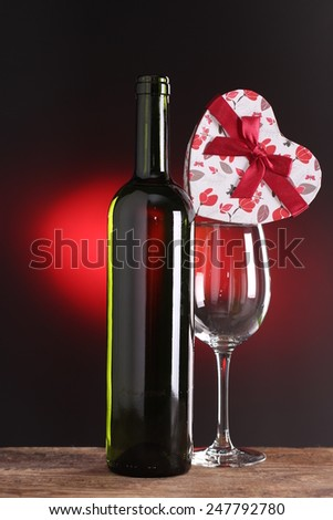 St Valentine's setting with present and red wine gift