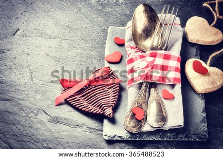 St Valentine's table setting with decorative hearts. Copy space