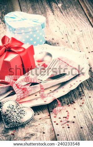 St Valentine's table setting with presents and decorative heart - stock photo
