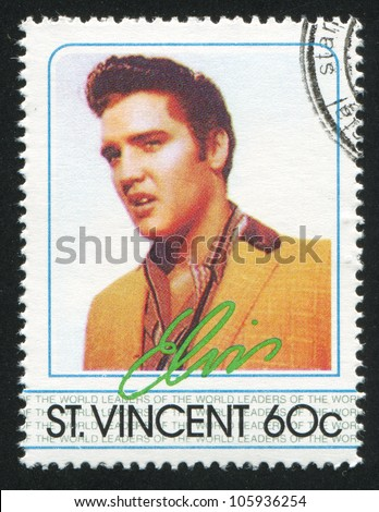ST. VINCENT - CIRCA 1985: A stamp printed by St. Vincent, shows Elvis Presley, American Entertainer, circa 1985. - stock photo