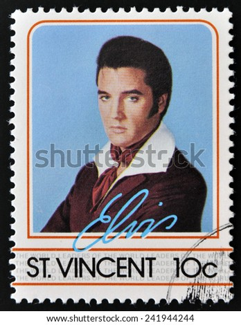 ST. VINCENT - CIRCA 1985: A stamp printed in St. Vincent, shows Elvis Presley, circa 1985.  - stock photo