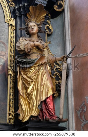 ST. WOLFGANG, AUSTRIA - DECEMBER 14: Saint Apollonia on the altar of St. Anne in Parish church in St. Wolfgang on Wolfgangsee in Austria on December 14, 2014.