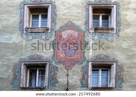 ST. WOLFGANG, AUSTRIA - DECEMBER 14: Virgin Mary with baby Jesus painting on house facade in St. Wolfgang on Wolfgangsee in Austria on December 14, 2014. - stock photo