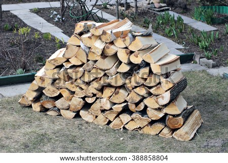 Stabel of chopped birch firewood - stock photo