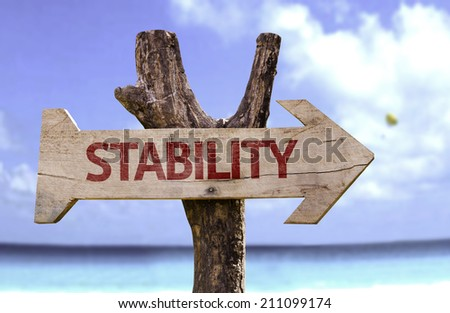 Stability wooden sign with a beach on background - stock photo