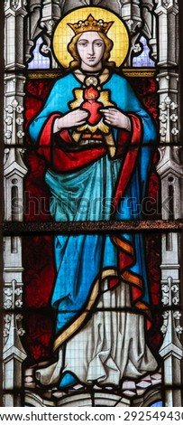 STABROEK, BELGIUM - JUNE 27, 2015: Stained glass window depicting Mother Mary in the Church of Stabroek, Belgium.