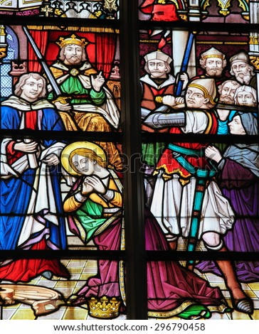 STABROEK, BELGIUM - JUNE 27, 2015: Stained glass window depicting Saint Catherine, martyr for the Catholic church, in the Church of Stabroek, Belgium.