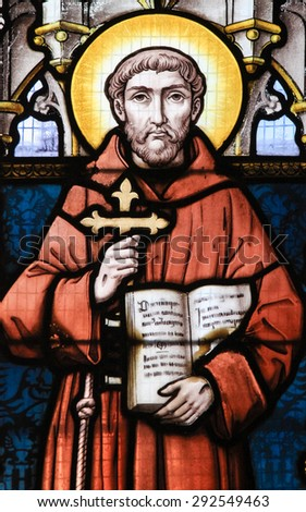 STABROEK, BELGIUM - JUNE 27, 2015: Stained glass window depicting Saint Francis of Assisi in the Church of Stabroek, Belgium.