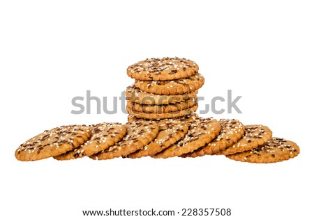 Stack and pile of round cookies with sesame and flax seeds isolated over white background. Shallow depth of field - stock photo