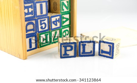 Stack and scattered alphabet wooden block letters and numbers. Concept of basic education. Isolated on white background. Slightly de-focused and close-up shot. Copy space. - stock photo