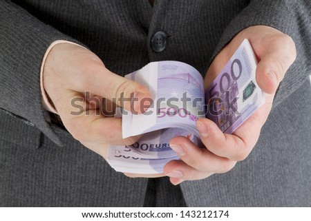 stack banknotes of five hundred euro in male hands - stock photo