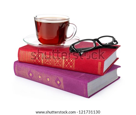 stack book with cap of tea and black glasses on white background - stock photo
