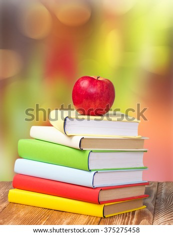 Stack books apple outdoor nature blur background empty space.Library study education concept.Back to school 1 september holiday. - stock photo