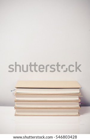 Stack books on a desk
