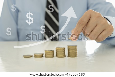 Stack coins in form of uptrend graph with investment advisor.  Financial planning and investment growth concept.