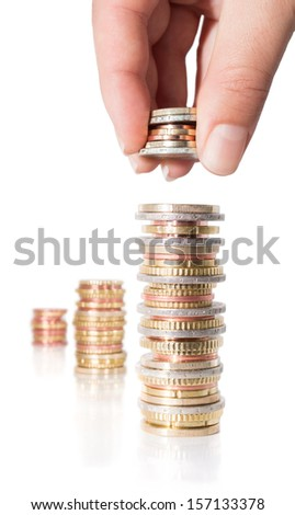 stack coins with hand -  increasing revenue  - stock photo