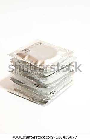Stack condoms on a white background