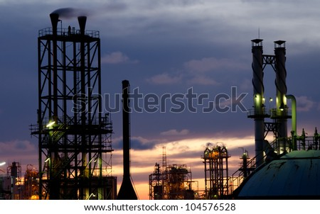 Stack in petrochemical plant at orange twilight