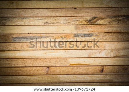Stack lumber in warehouse. Wooden background.