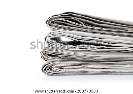 Stack newspapers on white