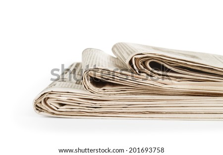 Stack newspapers on white - stock photo