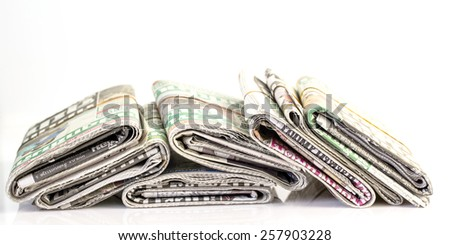 Stack newspapers on white background - stock photo