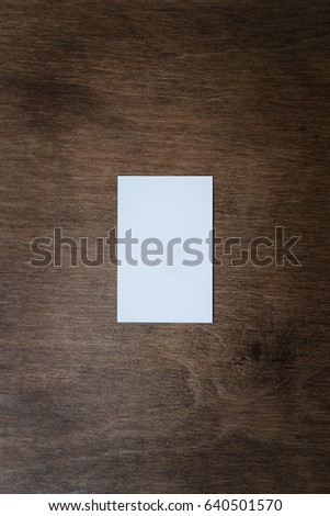 Stack of a blank business card on a dark wooden background. View from above. Layout for creating a corporate identity. Mockup of business cards fan stack on a dark wooden background. Business concept.