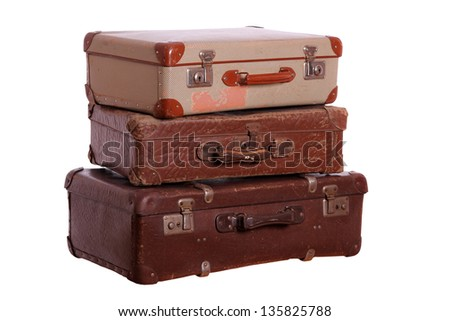 stack of aged suitcases - stock photo