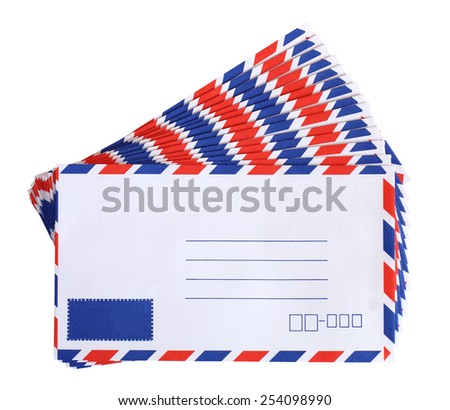 Stack of air mail envelopes on white background - stock photo