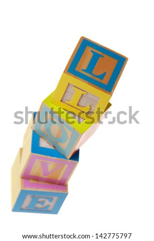 Stack of alphabet toy building blocks spelling the word love