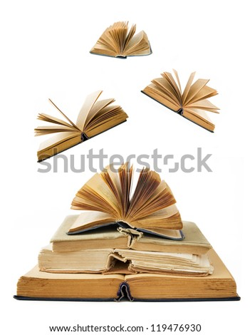 Stack of antique books with opened books flying away (education concept) - stock photo
